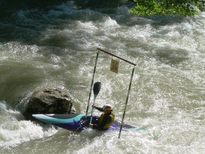 Kayaker passes through a gate